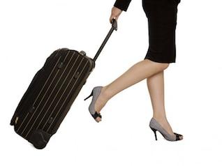 la maleta de un material foto con la mujer