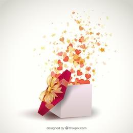 Abriendo un regalo lleno de corazones