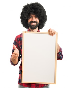 Afro, hombre, tenencia, vacío, cartel
