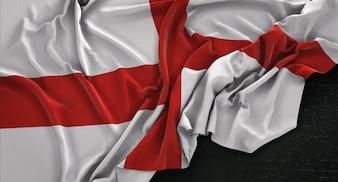 Bandera de Inglaterra arrugado sobre fondo oscuro 3D Render