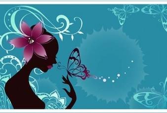 Silueta de la muchacha de la belleza con las flores