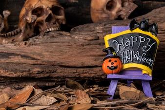 Bienvenido halloween partido bordo con el cráneo humano y el bosque de fondo