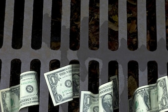 Billetes de dólar por el desagüe