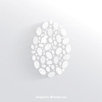 Blanco huevo de Pascua hecho de pequeñas siluetas de huevos
