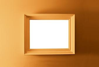 Blanco marco vacío en la pared de bronce