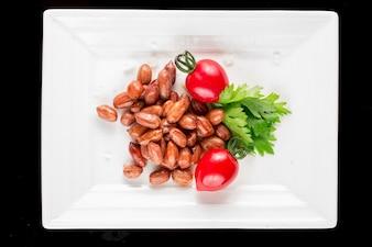 Cacahuetes a la brasa con tomates