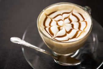 Café sabroso con estrella decorativa
