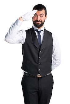 Camarero de lujo saludando
