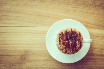 Cappuccino café en taza blanca