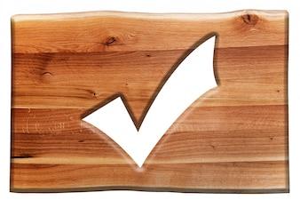 Cartel de madera con el símbolo de comprobado
