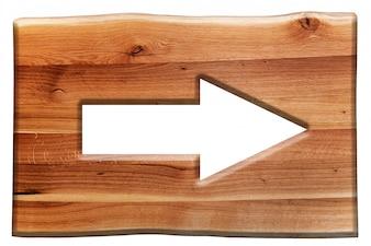 Cartel de madera con una flecha