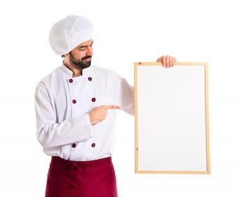 Chef que sostiene el cartel vacío