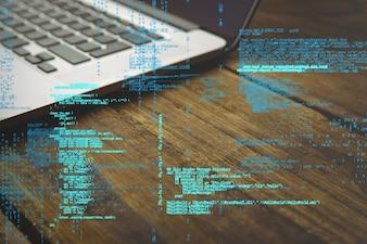 Código de programación con portátil de fondo