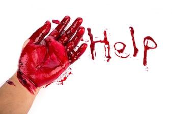 Concepto de Halloween: sangrado mano sobre el fondo blanco