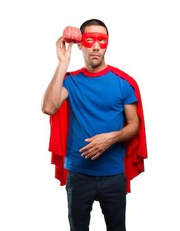 Concepto de un superhéroe que tiene un reto