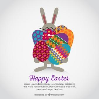 Conejito de Pascua transportando huevos