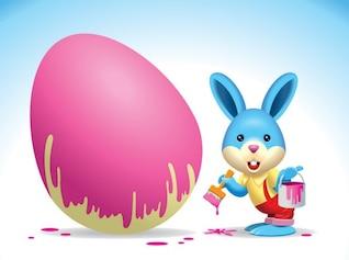 Conejo de Pascua que pinta un huevo Vector