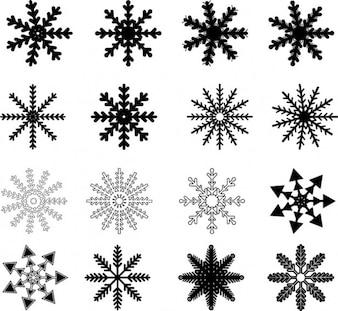 Copos de nieve negros dibujados conjunto de vectores
