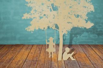 Corte del papel de los niños a leer un libro bajo el árbol
