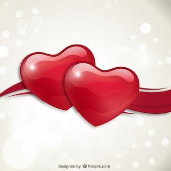 Fondo de par de corazones rojos