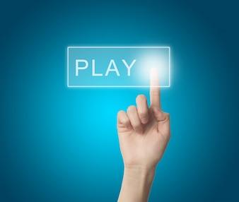 Dedo pulsando un circulo la palabra  jugar