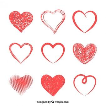 Dibujado a mano corazones rojos