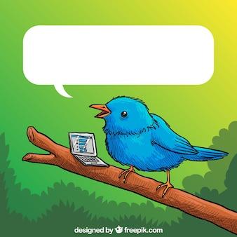 Dibujado a mano pájaro azul y un ordenador portátil