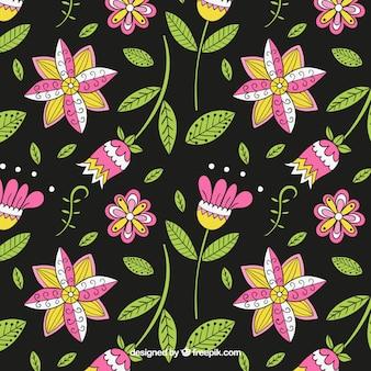 Dibujado a mano patrón de flores y hojas
