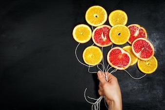 Dibujo de globos con rodajas de naranja