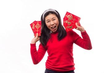 Dinero que la gente de papel asiática hermosa