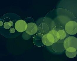 diseño abstracto bokeh contra el fondo verde oscuro
