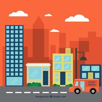 Edificios de la ciudad y un camión de comida