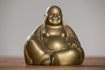 El oro pintado riendo figurilla de Buda