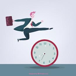 Empresarion saltando por encima de un reloj