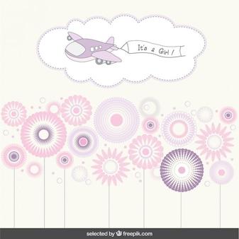 Es una tarjeta de ducha de bebé con un avión y flores