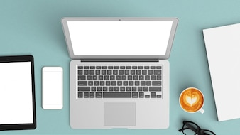 Escritorio azul con una tablet y un portátil