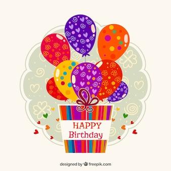 Etiqueta de cumpleaños con regalos y globos