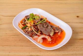 Filete de carne picante especias orientales