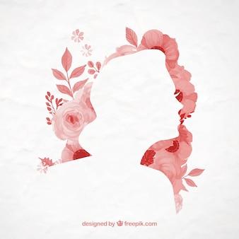 Flores pintadas a mano y una silueta femenina