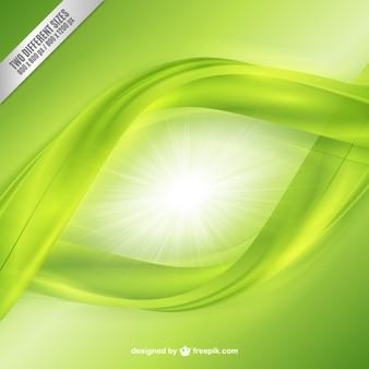 Fondo brillante con olas verdes