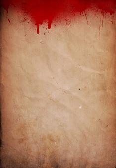 Fondo de halloween con salpicaduras de sangre en el papel del grunge