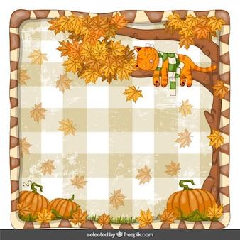 Fondo del otoño con el pequeño gato