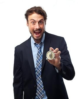 Hombre con traje y la boca abierta con un temporizador en la mano