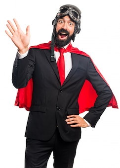 Hombre de negocios super héroe saludando