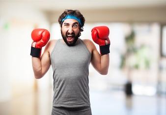 Hombre gritando con guantes de boxeador