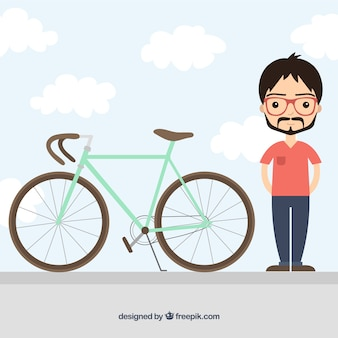 Hombre y una bicicleta retro