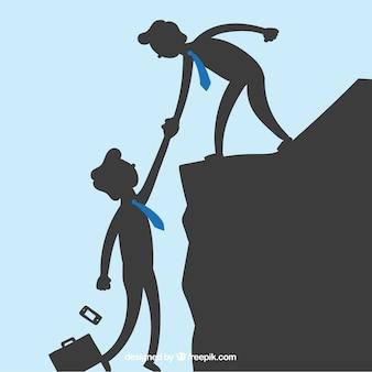 Hombres de negocios que se ayudan entre sí