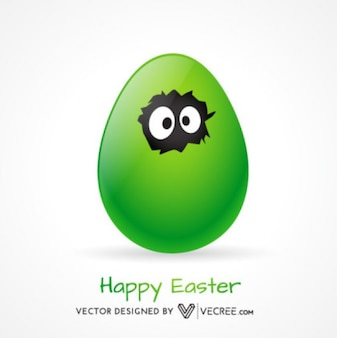 Huevo de Pascua verde con los ojos