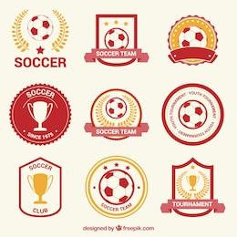 Insignias de fútbol rojo y oro