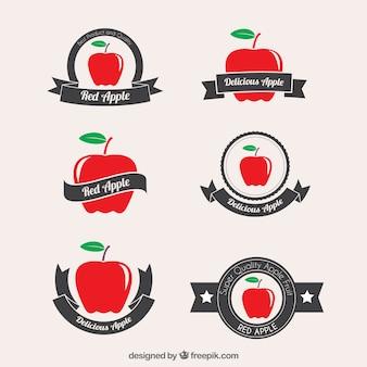 Insignias rojas de la manzana